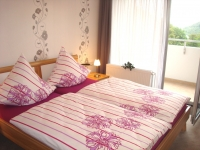 Die absolute Nachtruhe können Sie in dem Schlafzimmer mit Doppelbett (180x200) , 2. TV und Zugang zum Balkon finden