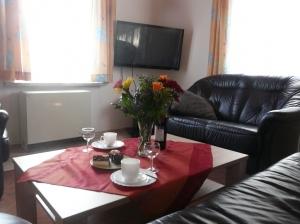 Wohnzimmer Ferienhaus mit Plasma Tv und Blu Ray Player